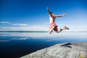 young man jumping on a rock
