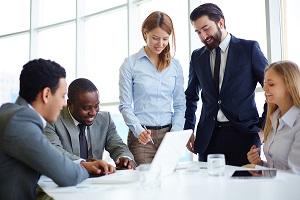 Group of businesspeople meeting in boardroom