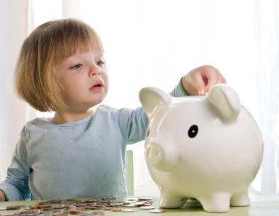 little-girl-piggy-bank