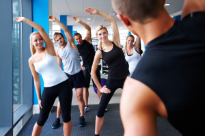 Fitness Instructor Leading Stretches