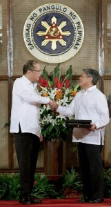 President Benigno S. Aquino III congratulates GSIS President and General Manager Robert Vergara during the conferment of  the Presidential Medal of Merit for outstanding service to the Aquino Administration.