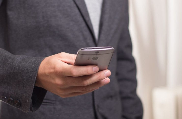 phone to make payments Small-Business-Outsource