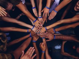 Team Bonding Boost Morale in Your Office Environment team building hands